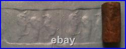 Ancient Sumerian brown stone cylinder seal with animal contest scene