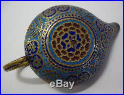 Antique Middle Eastern champleve enamel on brass chamberstick with snake handle