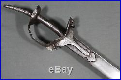 Indo Persian khanda hilted talwar with a kilij shape blade India 19th century